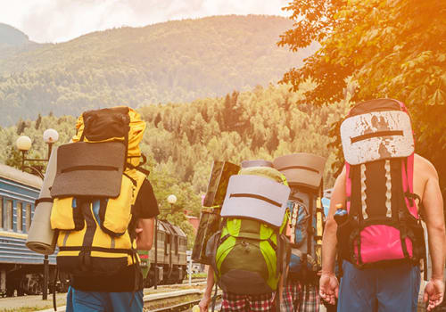 Tourists,Or,Travelers,With,Backpacks,On,Their,Back,Travel,To