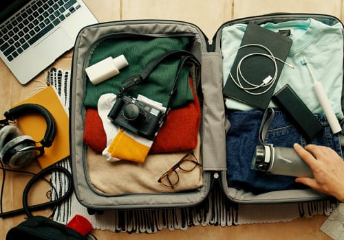 Man,With,Tatted,Arm,Packs,Suitcase,For,Adventure,Travel,Trip.