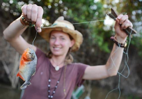 Young Woman is Piranha Fishing