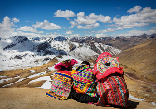 Persons,Contemplating,The,Andes,In,Perãº