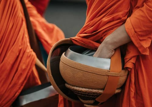 A monk holding a bowl for the alms