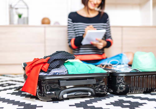 eautiful,Young,Woman,Packing,Her,Stuff,Into,A,Big,Suitcase.