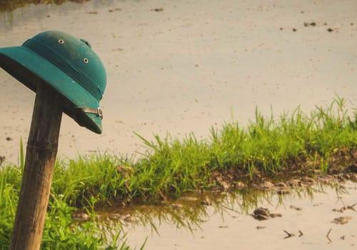 Vietnamese military helmet on a bamboo pole