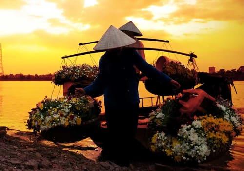 women selling flowers on a boat