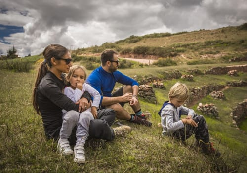 Happy Family Enjoying The View In the Sacred valley Of The Incas In Cusco - Peru