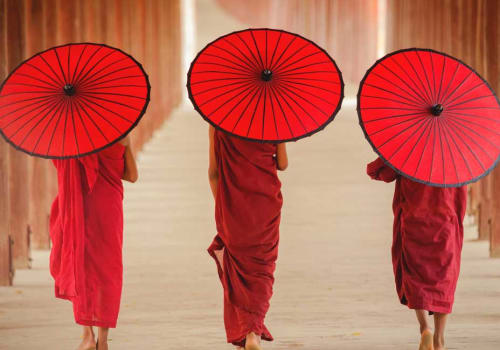 Burmese monks walking with the traditional umbrellas