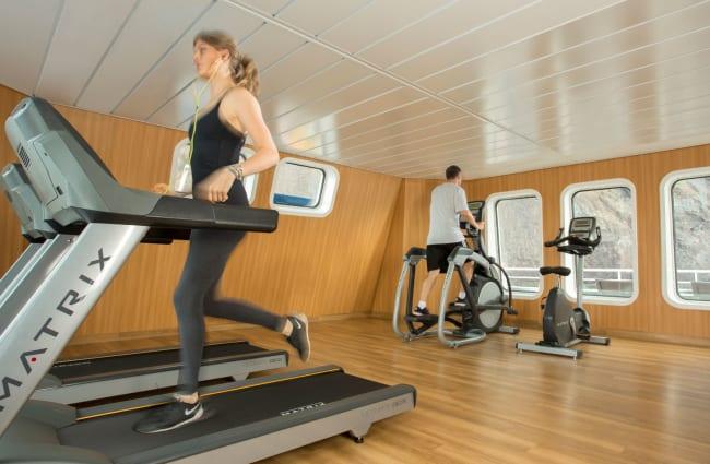 Woman jogging at the gym onboard Santa Cruz II
