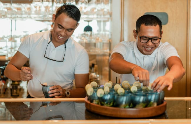 Two smiling bartenders