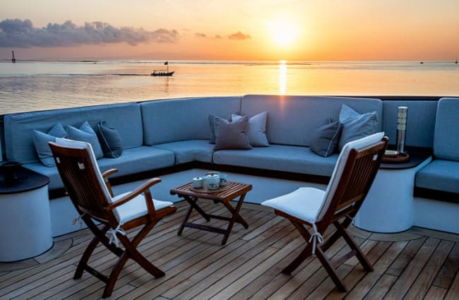 Chairs and sofa on the deck in the sunset light