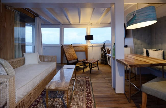 Room with desk and sofa onboard