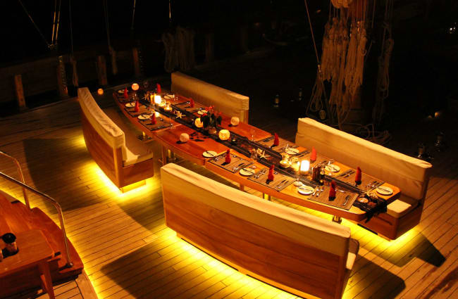 Table set up on the deck at night