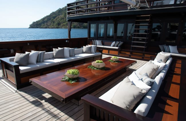 Sofas and a table on the open deck