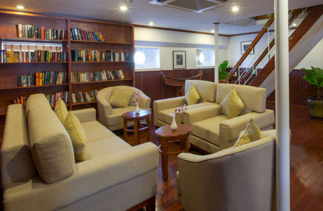 A library and reading corner onboard Mekong Pandaw