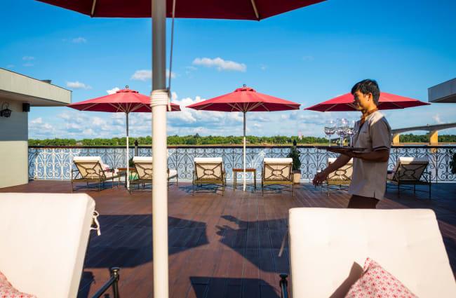 Waiter walking through Outdoor Lounge
