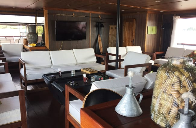 Lounge with armchairs and games