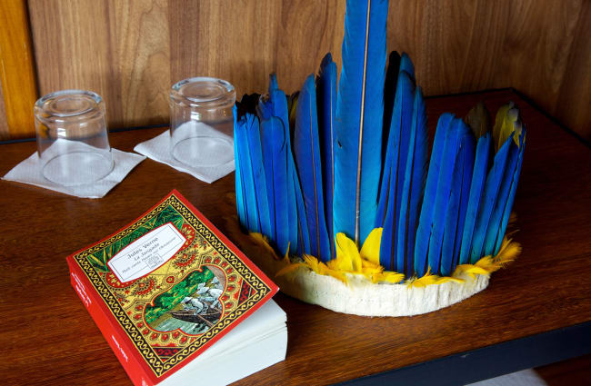 A book and traditional head cover on the shelf