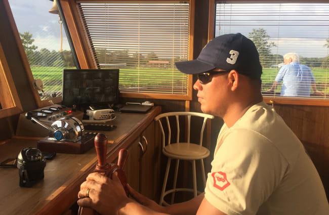 Navigator steering the ship