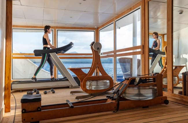 Woman exercising at the onboard gym