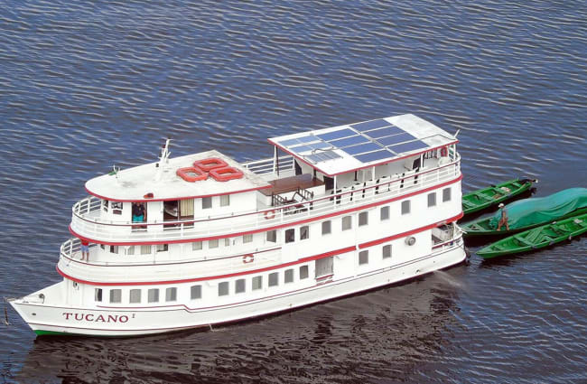 A boat with solar panels on top deck