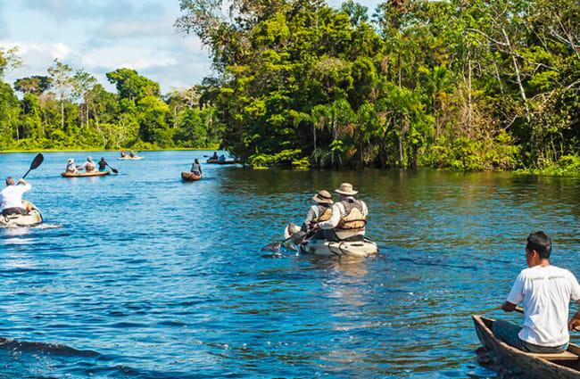 kayaking people in the amazon rainforest