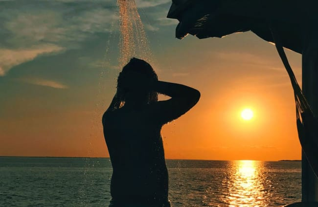Showering outdoors during sunset