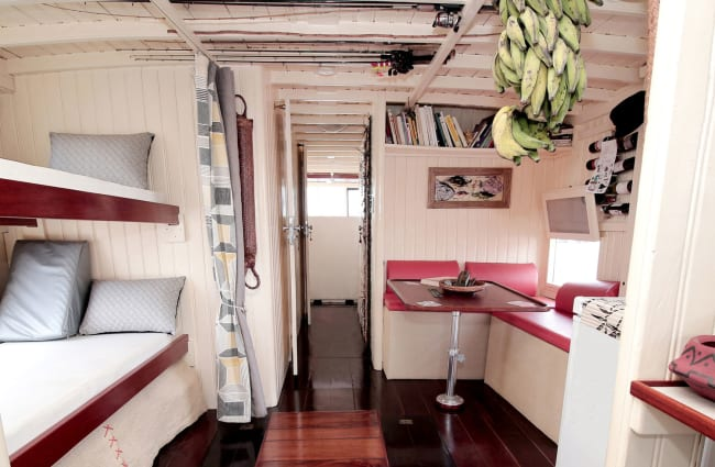 Interior with bunk beds and a reading area