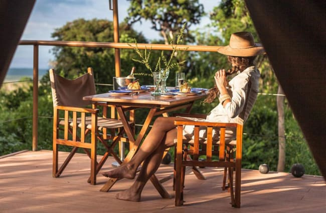 A woman at the table outdoors