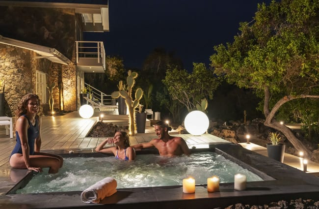 Happy people in the jacuzzi in the evening