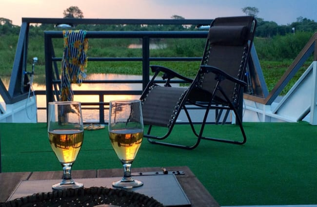 Two wine glasses on the deck table