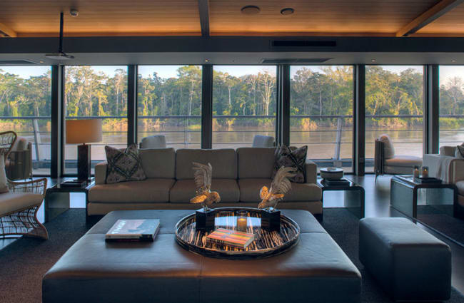 Sofa and coffee table with the Amazon river view