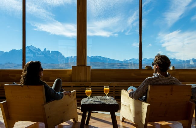 couple looking at the view from the lobby at the tierra patagonia hotel