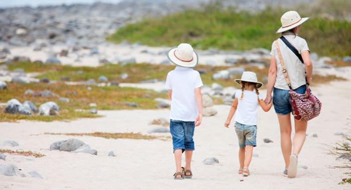 Family walking on Galapagos beach