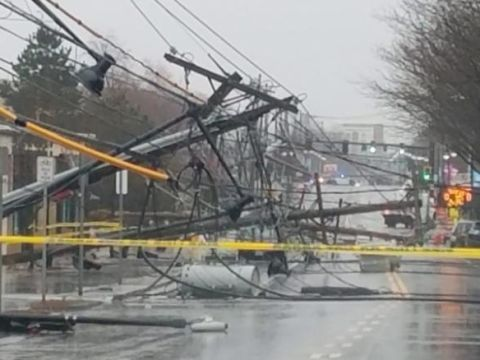 Telephone poles litter the ground Friday, March 2, 2018, in Watertown, Massachusetts. | ClimeNews