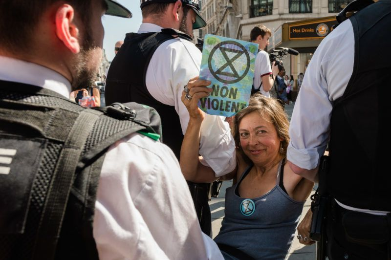 Police forces arrest an Extinction Rebellion protester for blocking Oxford Circus on day six of protest action on 20 April, 2019 in London, England. The protest is part of global 'International Rebellion' movement calling for decisive action from governments in the face of climate change and ecological collapse to avoid the possibility of human extinction in the near future. (Photo by WIktor Szymanowicz/NurPhoto via Getty Images)