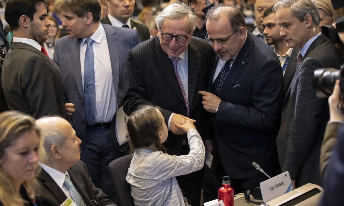 Greta Thunberg shakes Jean-Claude Juncker's hand at the Civil Society for rEUnaissance event in Brussels. Photograph: Maja Hitij/Getty Images