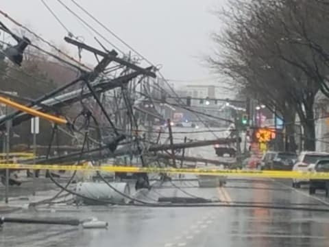 Telephone poles litter the ground Friday, March 2, 2018, in Watertown, Massachusetts.   ClimeNews