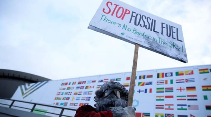 ClimeNews   Environmental activist protests against fossil fuel in front of the the venue of the COP24 UN Climate Change Conference 2018 in Katowice, Poland. (Reuters)