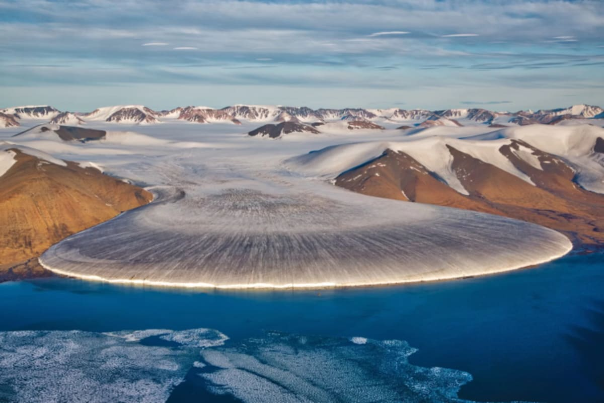 At the beginning of the Quaternary period, glaciers crept down from Greenland to cover much of North America and northern Europe. Here, a glacier in North Greenland. Credit: Nicolaj Larsen/Shutterstock