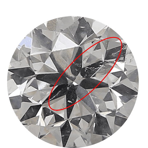 Red arrow pointing to thin veils in round diamond called twinning wisps