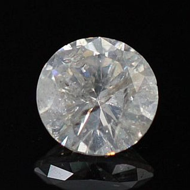 Round diamond against a black background that has turned milky from twinning wisps