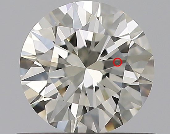 A round diamond against a gray background has a red circle around a small white line, called a feather