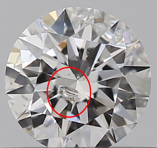 A round diamond against a gray background has a red circle around a large break in the diamond, called a feather