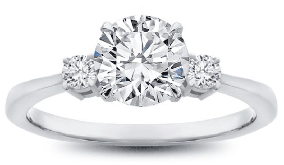 Round diamond in a three stone setting