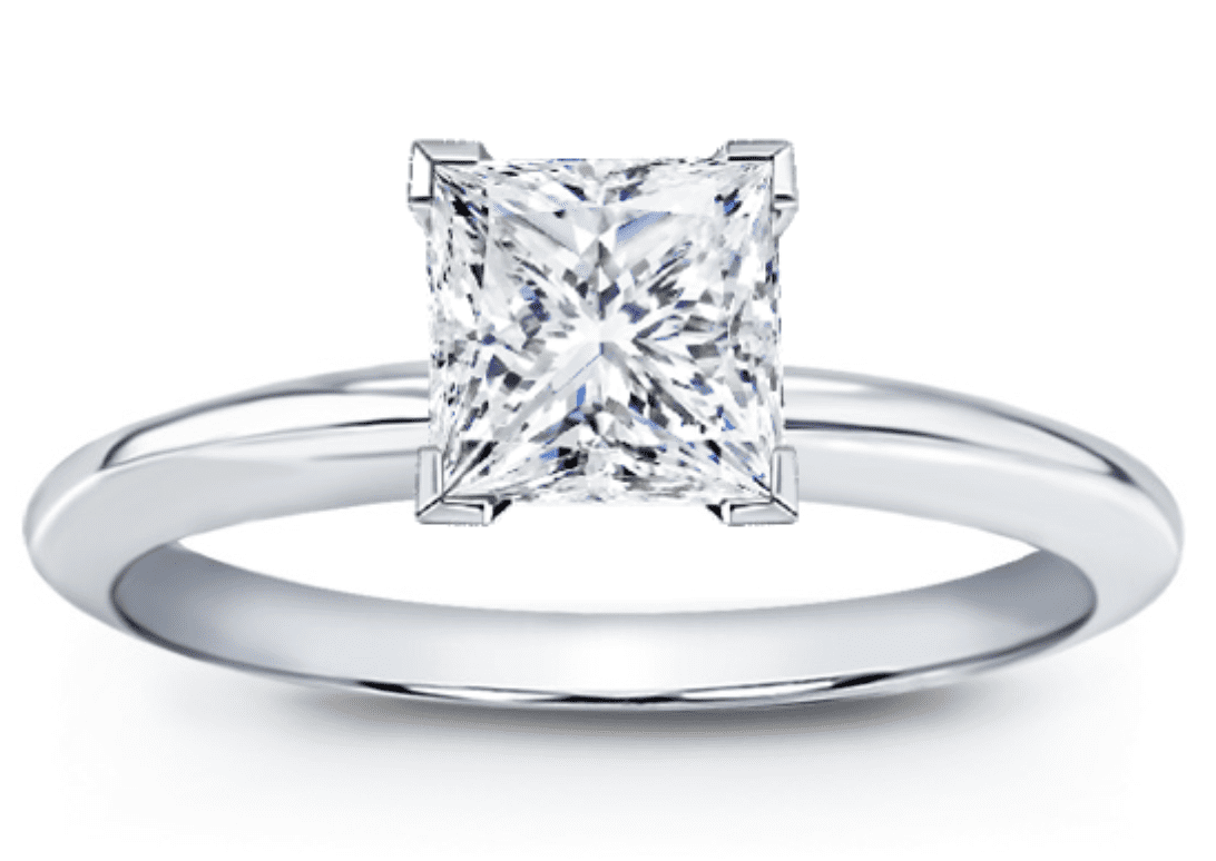 Solitaire princess cut diamond ring with v-cap prongs to protect the corners set in white metal