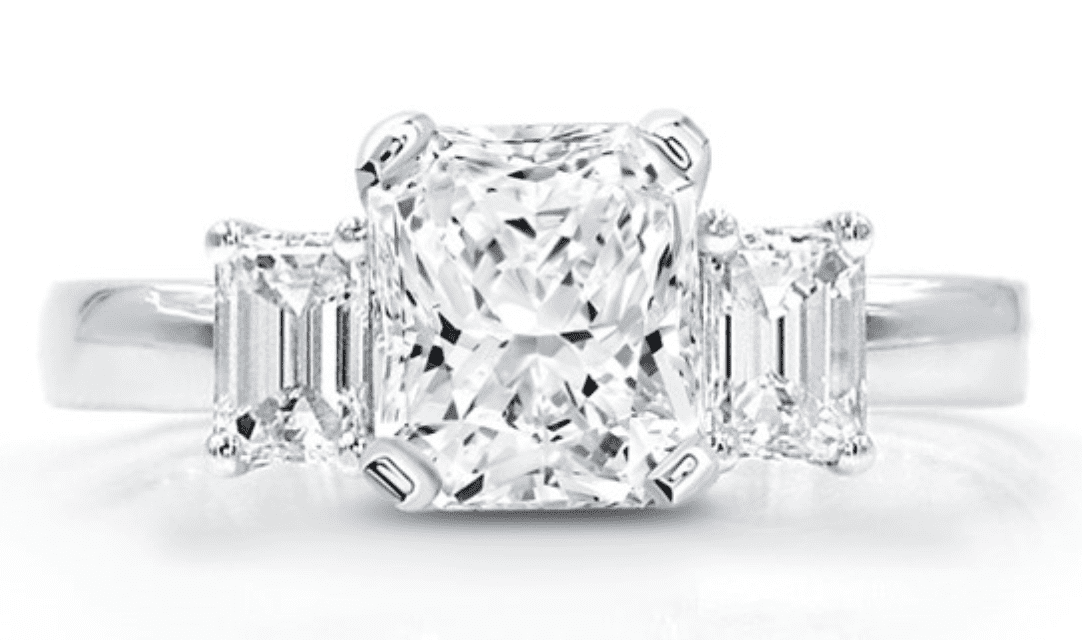 a radiant center stone with emerald cut flanking it. 3 stone