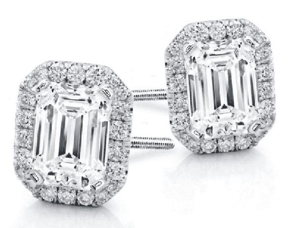 emerald cut studs surrounded by a round diamond halo