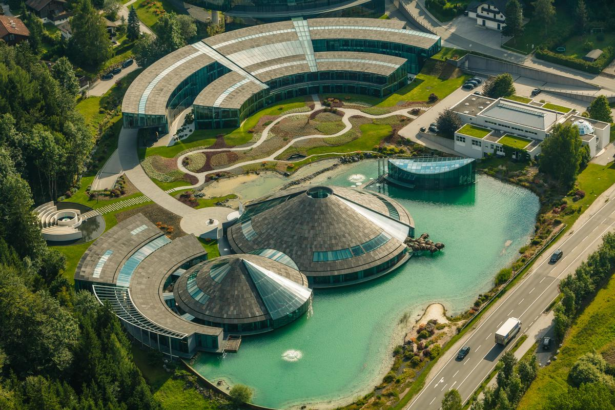 Red Bull headquarter Austria in Fuschl am See near Salzburg with a man-made pond and surrounded by green landscape