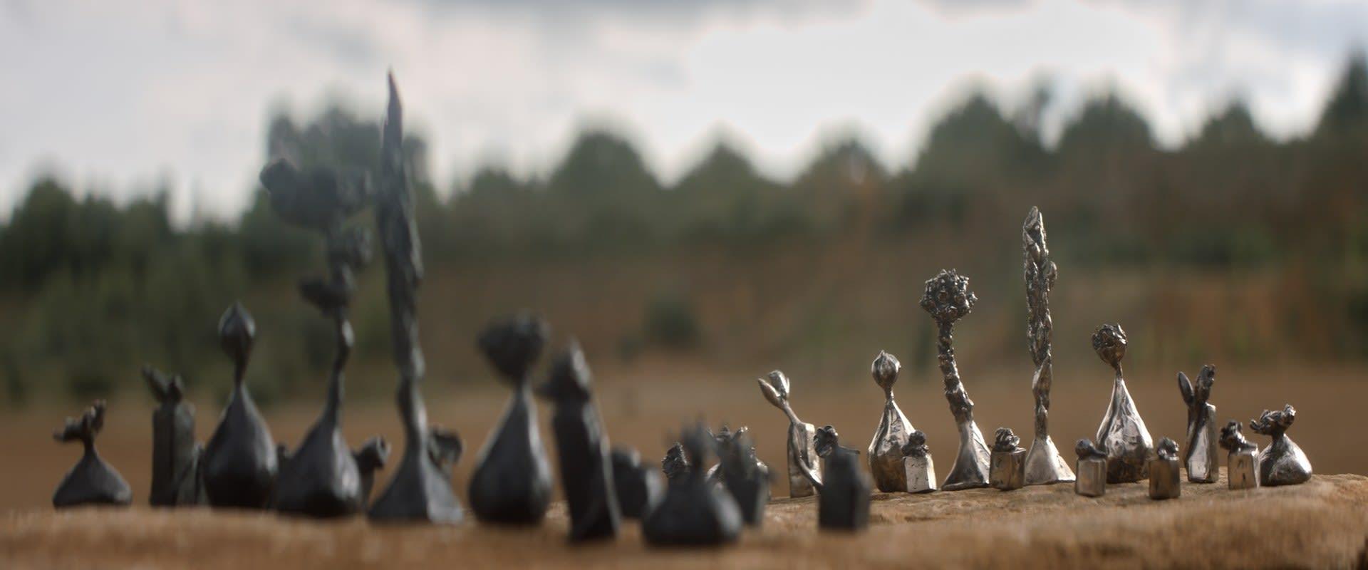 The bronze chess set.