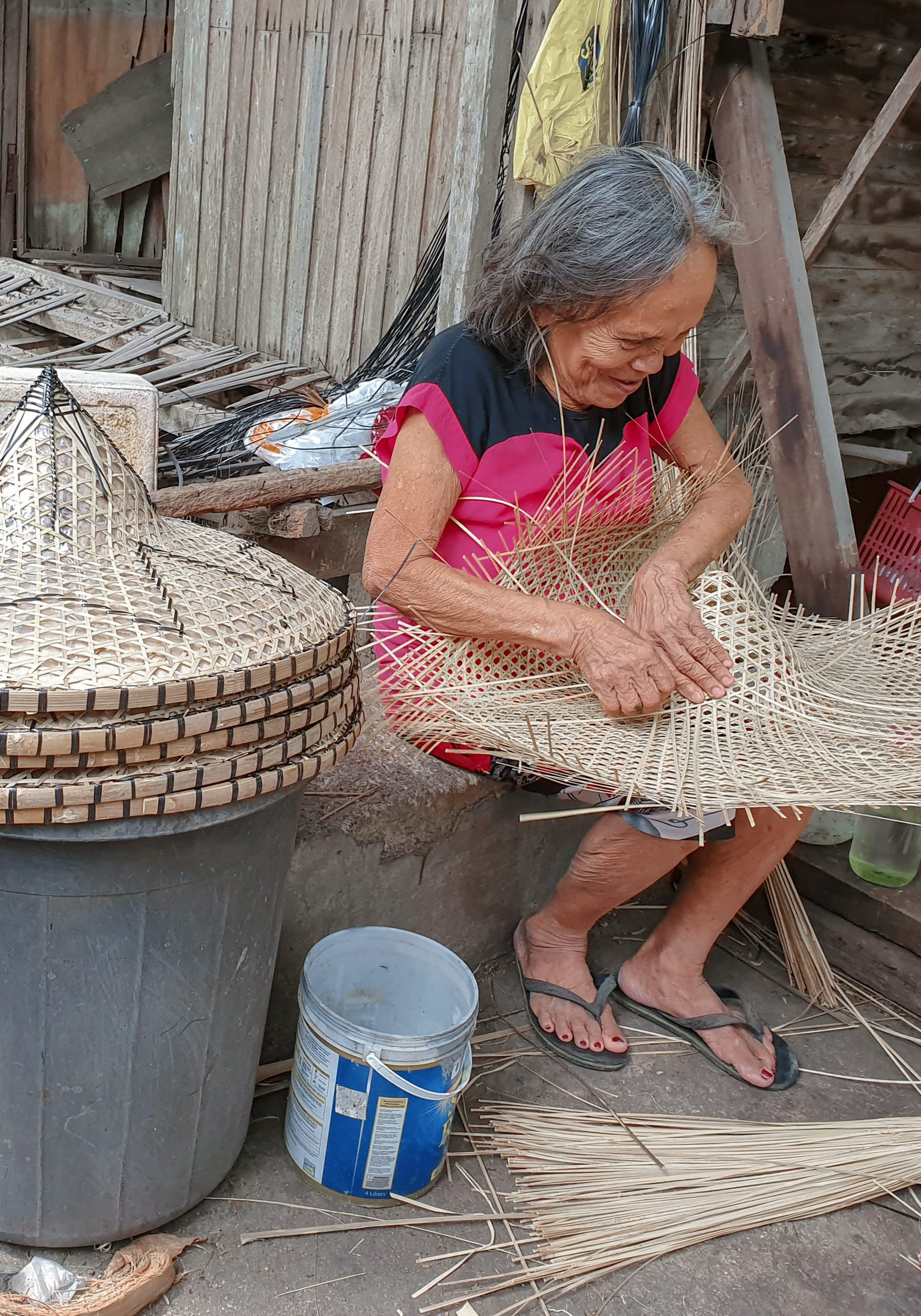 Weaving the strips into a rain hat