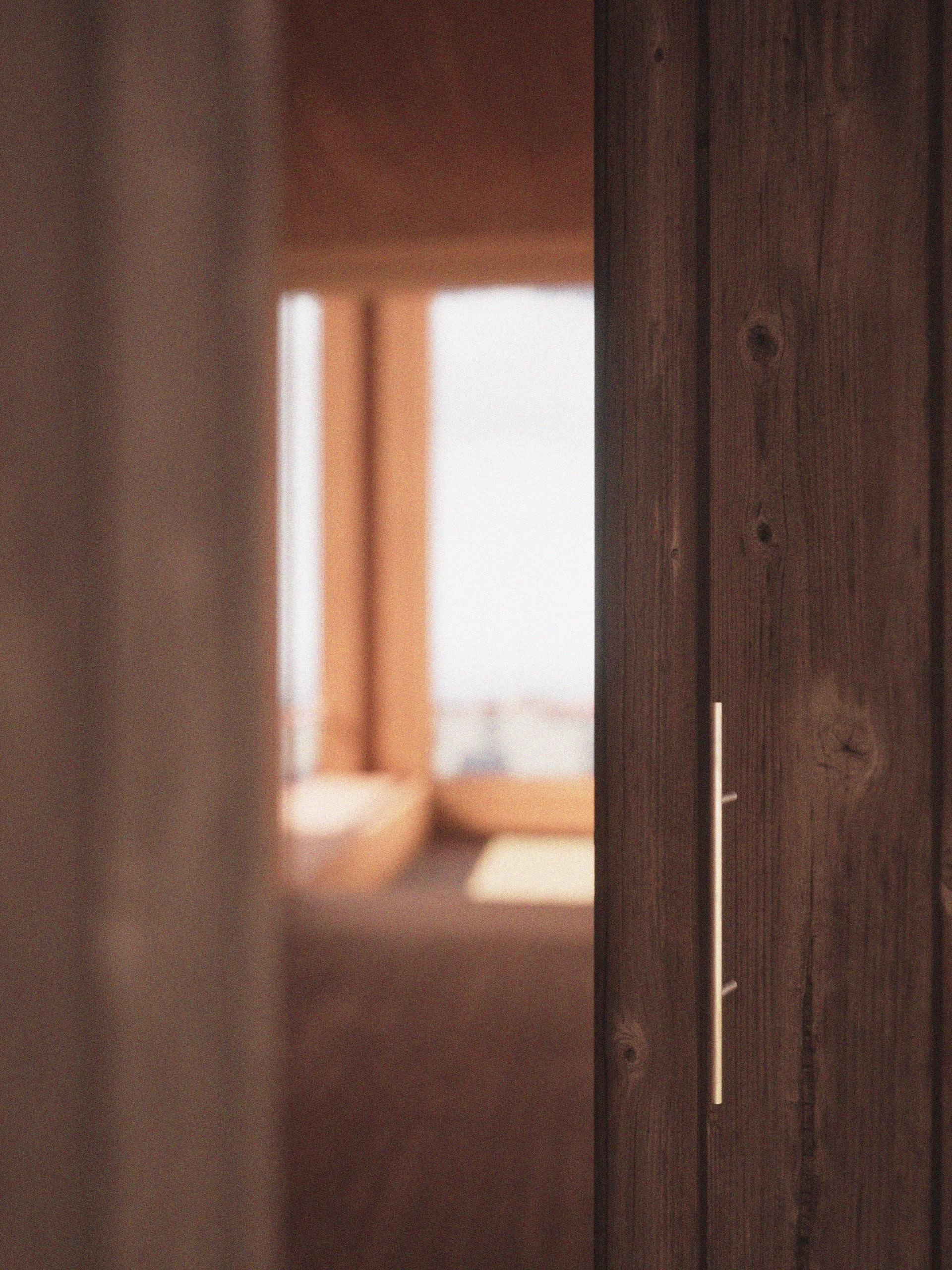 Delicate copper handles between spaces